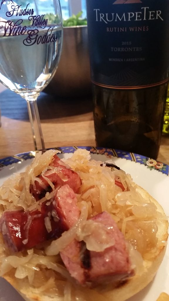 Kielbasa with caramelized onions, sauerkraut paired with 2015 Rutini Trumpeter Torrontes