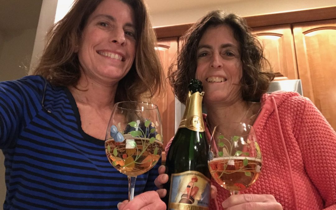 Sisters Sharing Wine Made By Sisters